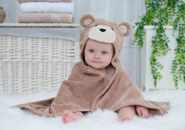 baby with brown bamboo towel