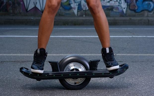 girl skating e-board