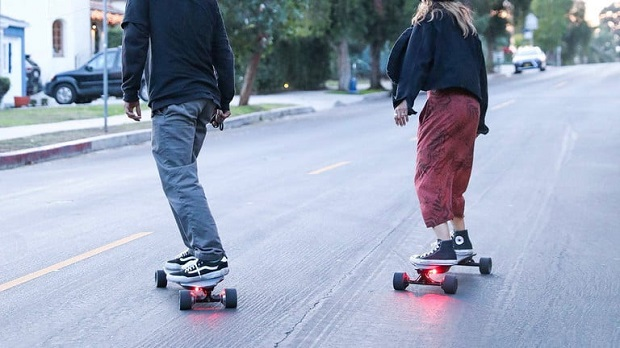 couple cruising on e-board