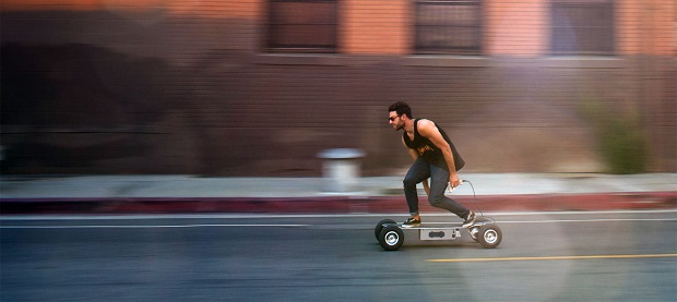 guy cruising with e-board