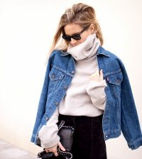 girl wearing winter skivvie under denim jacket with black skirt