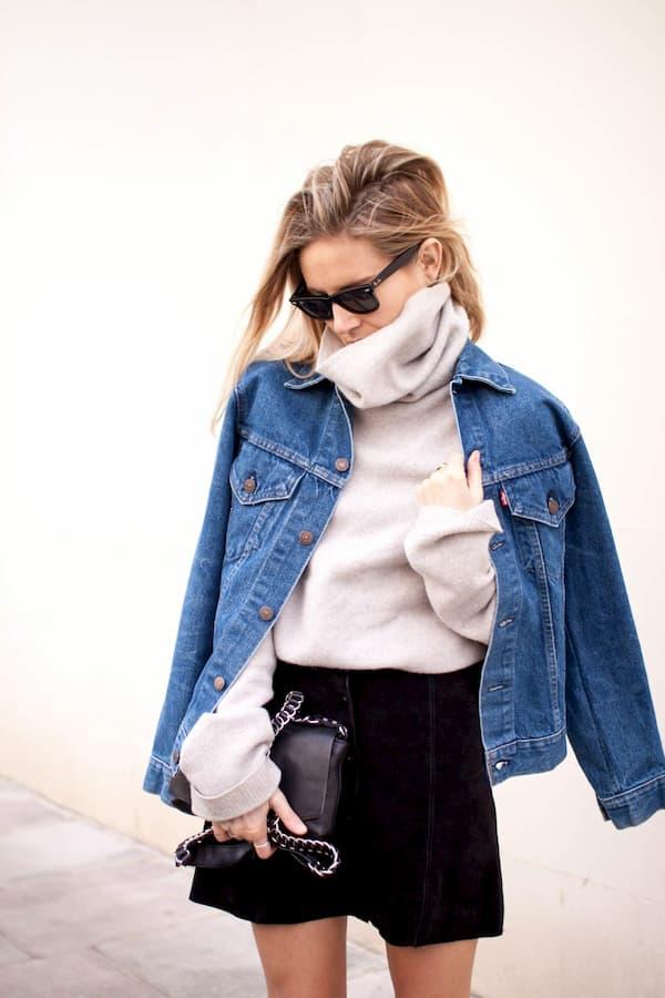 girl wearing winter skivvie under denim jacket with black skirt