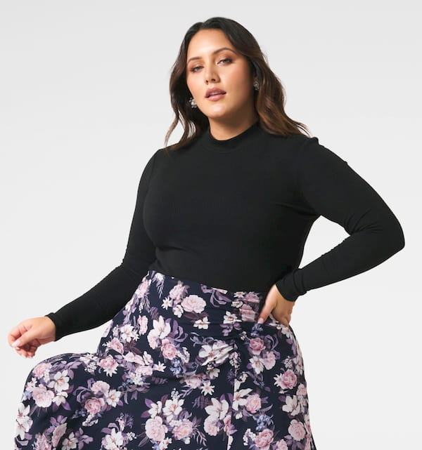 woman wearing black skivvie with maxi skirt with flowers