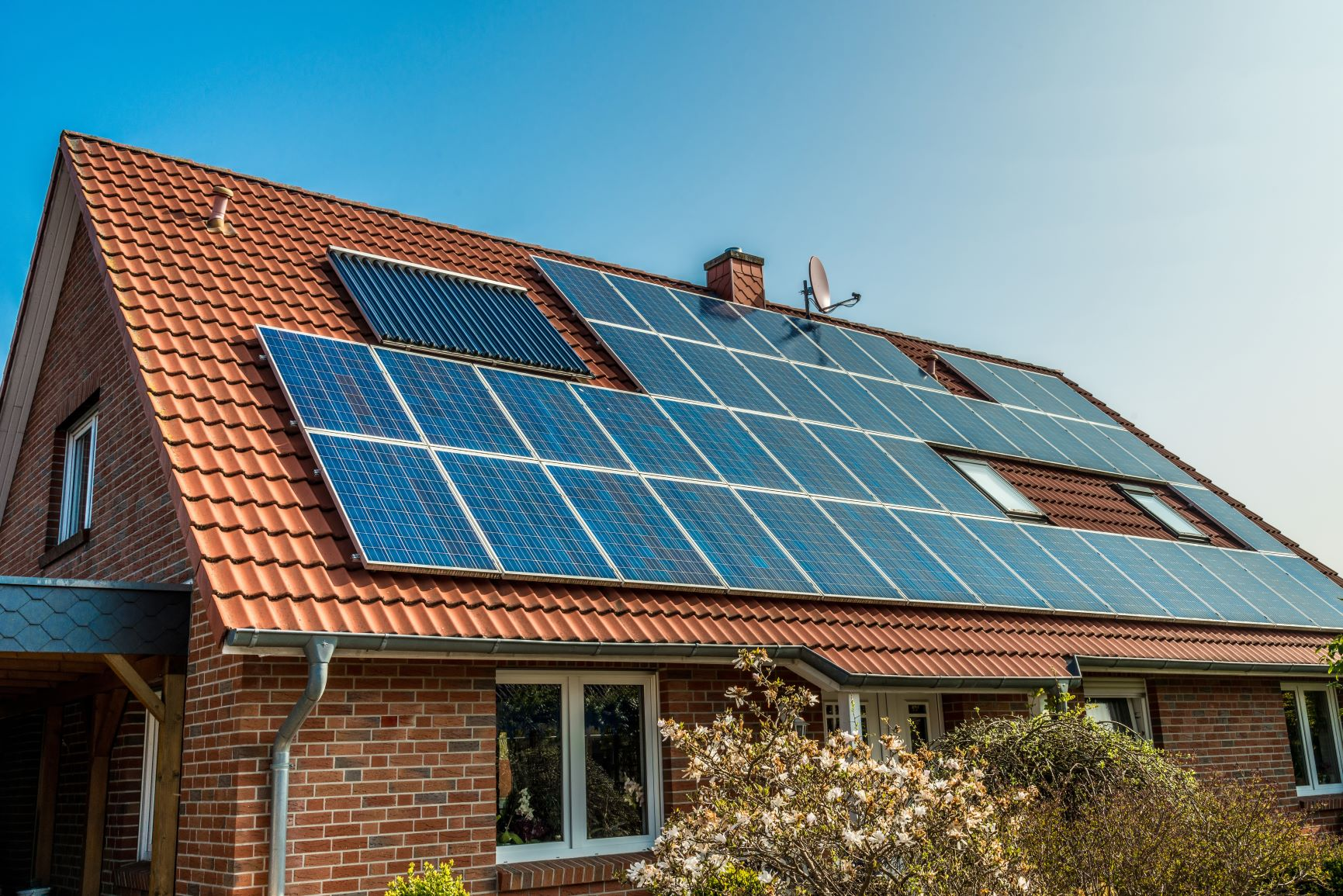solar panel installers on house