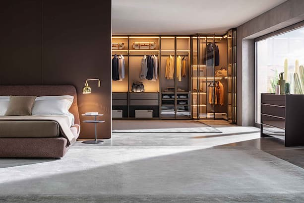italian wardrobe design with glass doors and modern bed