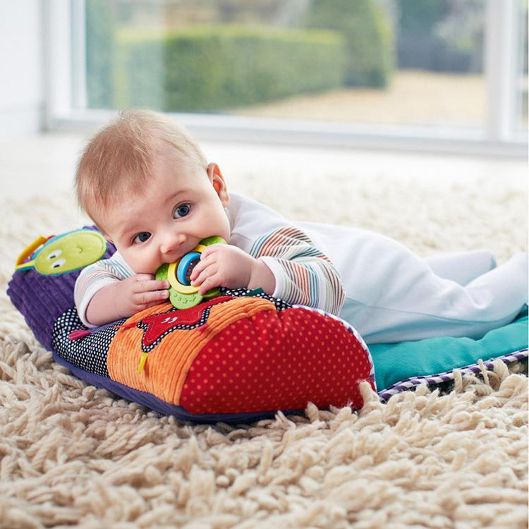 picture of infant on the floor playing
