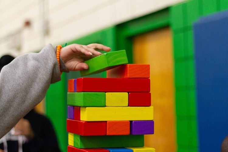 picture of a kid playing building blocks